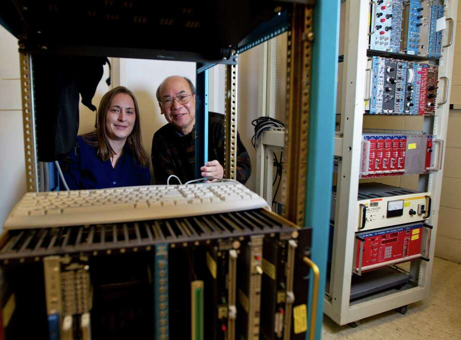 University of Houston physicists Lisa Whitehead and Kwong Lau were part of an international team of researchers involved in an experiment in China that made a critical measurement of neutrinos. Photo: Karen Warren, Staff / © 2012 Houston Chronicle