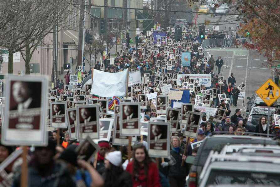 Marchers make their way through Capitol Hill during Seattle's annual march to honor Martin Luther Ki