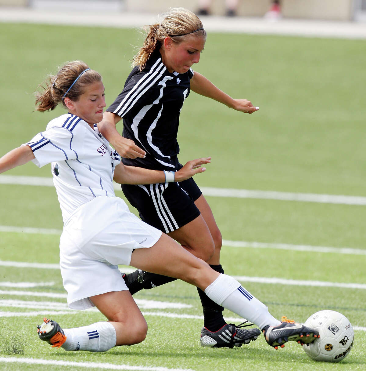 Seven Lakes' Lauren Harrington, left, adds defense like this to her ability to find the net.
