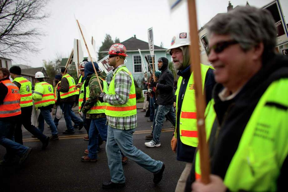Union-affiliated construction workers march during Seattle's annual march to honor Martin Luther King, Jr. on Monday, January 21, 2013. The federal holiday recognizes the birthday of the civil rights leader. Photo: JOSHUA TRUJILLO, SEATTLEPI.COM / SEATTLEPI.COM