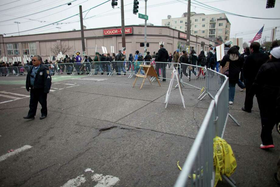 A crowd control barrier encircles the Seattle Police Department East Precinct during Seattle's annual march to honor Martin Luther King, Jr. on Monday, January 21, 2013. The federal holiday recognizes the birthday of the civil rights leader. Photo: JOSHUA TRUJILLO, SEATTLEPI.COM / SEATTLEPI.COM