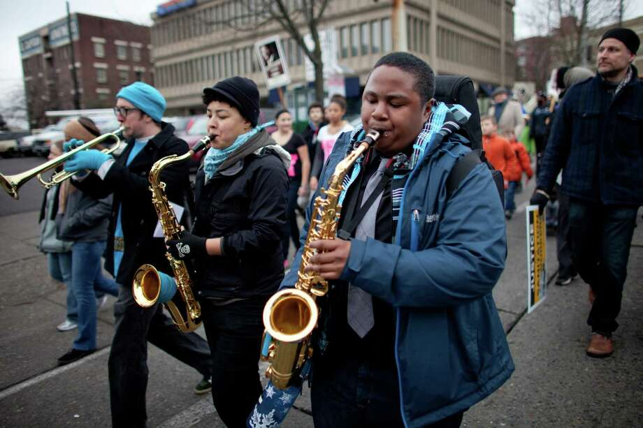 Musicians perform during Seattle's annual march to honor Martin Luther King, Jr. on Monday, January 21, 2013. The federal holiday recognizes the birthday of the civil rights leader. Photo: JOSHUA TRUJILLO, SEATTLEPI.COM / SEATTLEPI.COM