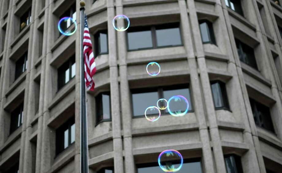 Bubbles float skyward in front of the Henry M. Jackson Federal Building during Seattle's annual march to honor Martin Luther King, Jr. on Monday, January 21, 2013. The federal holiday recognizes the birthday of the civil rights leader. Photo: JOSHUA TRUJILLO, SEATTLEPI.COM / SEATTLEPI.COM