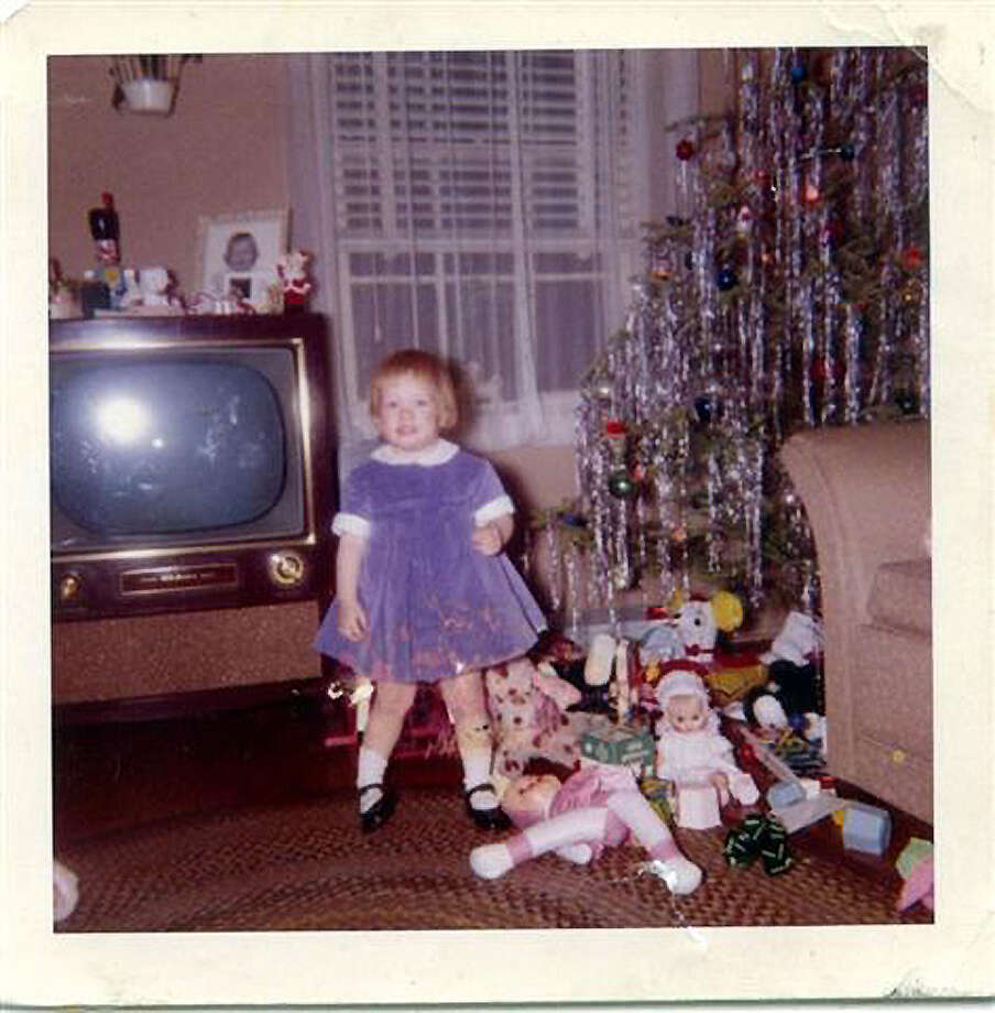 For Cynthia Alice Jones Zizzi of Cos Cob, Christmas is tinsel and a blue velvet dress.
