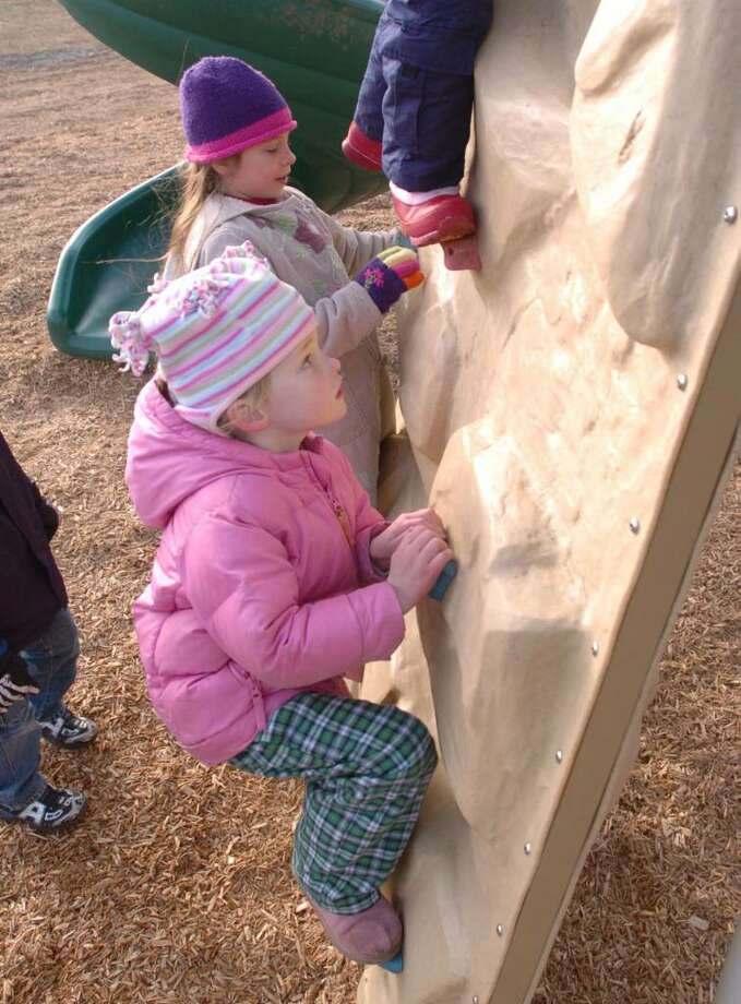 From left or rear, Alana Alves, 7 and Sarah Falder, 5, both of New Milford, play at the New Milford Creative Playground Wednesday, Dec. 23, 2009. Photo: Chris Ware / The News-Times