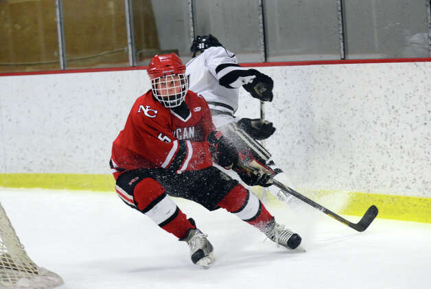 New Canaan's Davis Bruch (5) on the ice during the boys hockey game against Xavier at the Freeman Athletic Center in Middletown on Monday, Jan. 21, 2013. Photo: Amy Mortensen / Connecticut Post Freelance