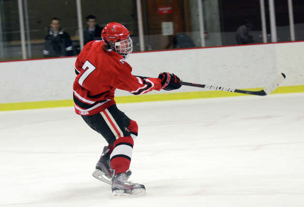 New Canaan's Benjamin Patch (7) takes a shot on goal during the boys hockey game against Xavier at the Freeman Athletic Center in Middletown on Monday, Jan. 21, 2013. Photo: Amy Mortensen / Connecticut Post Freelance