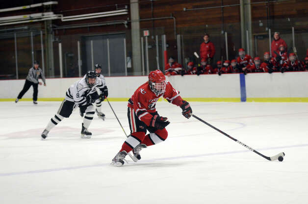 New Canaan's Benjamin Patch (7) controls the puck during the boys hockey game against Xavier at the Freeman Athletic Center in Middletown on Monday, Jan. 21, 2013. Photo: Amy Mortensen / Connecticut Post Freelance