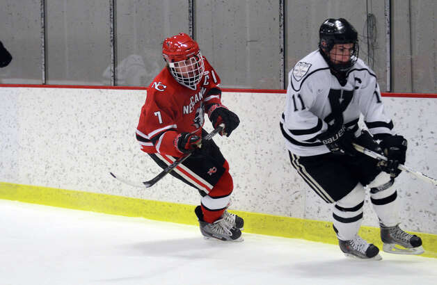 New Canaan's Benjamin Patch (7) and Xavier's Dan Dupont (11) go after the puck during the boys hockey game at the Freeman Athletic Center in Middletown on Monday, Jan. 21, 2013. Photo: Amy Mortensen / Connecticut Post Freelance