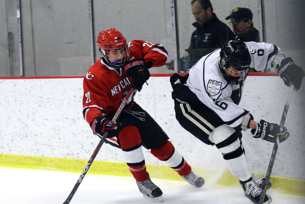 New Canaan's Patrick Hompe (22) on the offense as Xavier's Evan Lindquist (6) defends during the boys hockey game at the Freeman Athletic Center in Middletown on Monday, Jan. 21, 2013. Photo: Amy Mortensen / Connecticut Post Freelance
