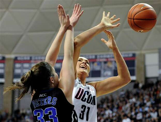 UConn's Stefanie Dolson is stopped by Duke's Haley Peters, left, during the first half of an NCAA college basketball game in Storrs, Conn., Monday, Jan. 21, 2013. (AP Photo/Jessica Hill)
