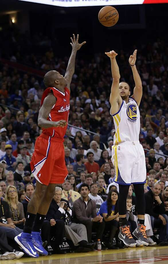 Stephen Curry shoots a three-pointer over Jamal Crawford. Curry made four in the fourth quarter, six in the game. Photo: Marcio Jose Sanchez, Associated Press
