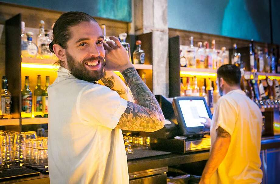 Bartender Matthew Campbell shakes a Margarita in the front bar at Comal. Photo: John Storey, Special To The Chronicle