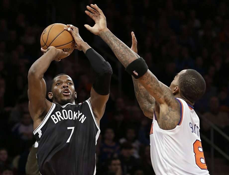 Joe Johnson's go-ahead jumper over New York's J.R. Smith with 22 seconds left gives the Nets a share of the season series. Photo: Kathy Willens, Associated Press