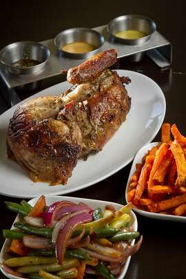 The Half Chicken with sides of Veggies and Sweet Potato Fries at Limon Rotisserie in San Francisco, Calif., is seen on Thursday, October 18th, 2012.
