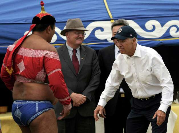 The Happy Warrior at play: Biden gestures to a Mongolian wrestler during a mini Naadam staged in his honour in Ulan Bator in 2011. (GOH CHAI HIN/AFP/Getty Images) Photo: GOH CHAI HIN, Multiple / 2011 AFP