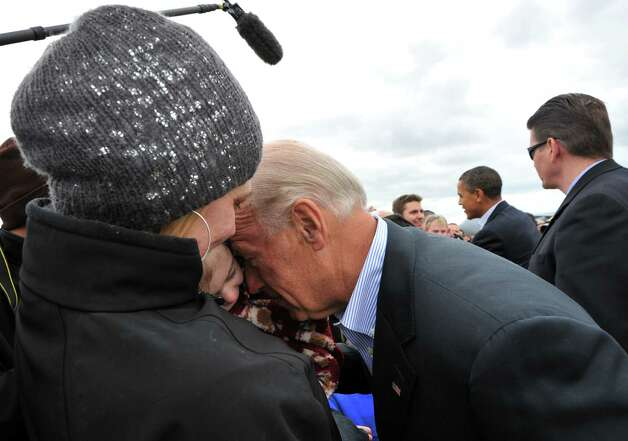 The Happy Warrior Nuzzle. Biden greeting a group of people upon his arrival in Cleveland, Ohio, in 2010. (Photo credit should read JEWEL SAMAD/AFP/Getty Images) Photo: JEWEL SAMAD, Multiple / 2010 AFP