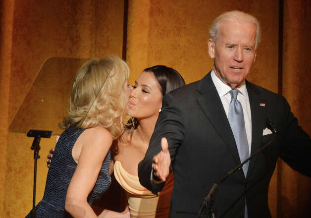 Hey, they're huggers and kissers. Jill Biden does the Happy Warrior Cheek Peck.(Photo by Rick Diamond/Getty Images for Latino Inaugural 2013) Photo: Rick Diamond, Multiple / 2013 Getty Images