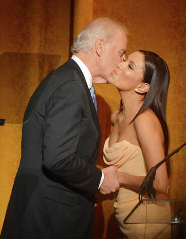 That's one, oh Happy Warrior. Actress Eva Longoria greets Biden at Latino Inaugural 2013: In Performance at Kennedy Center at The Kennedy Center on Sunday in Washington, DC.  (Photo by Rick Diamond/Getty Images for Latino Inaugural 2013) Photo: Rick Diamond, Multiple / 2013 Getty Images