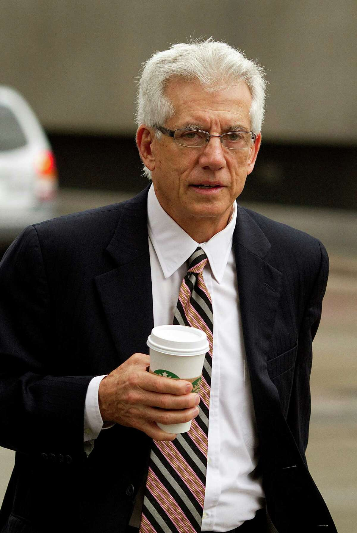 James Davis, former chief financial officer of Stanford Financial Group Co., arrives at court in February 2012. Davis could be given probation or sentenced to as many as 30 years in prison at his sentencing Tuesday. Davis has asked for a sentence of no more than four years in prison.