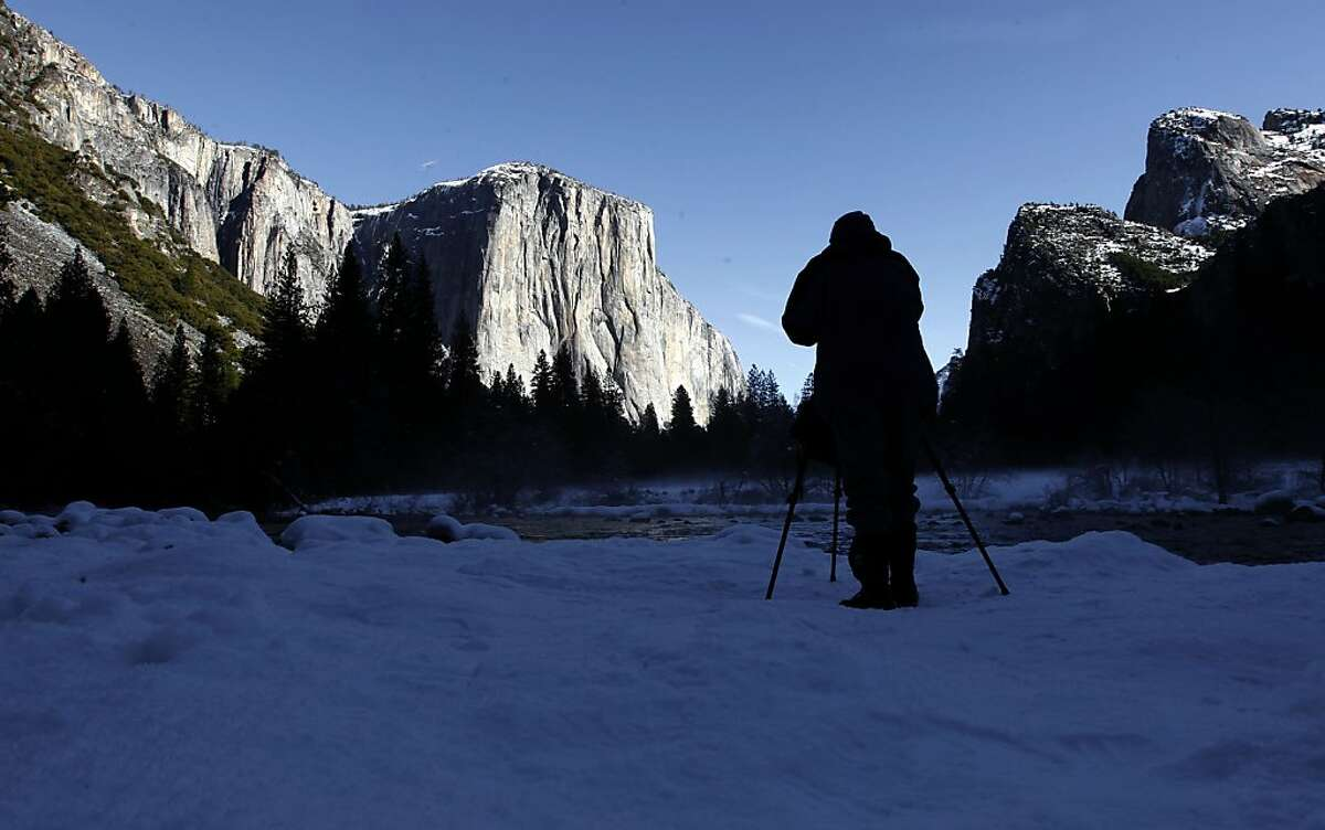 Photographer Lance Trott, of San Jose, records the beauty of Yosemite Valley, Calif., with El Capitan rising in the background, on Tuesday Jan. 8, 2013. Yosemite National Park announced today the release of two Wild and Scenic River comprehensive Management Plan Draft Environmental Impact Statements for the Merced River and the Tuolumne River for public review and comment.