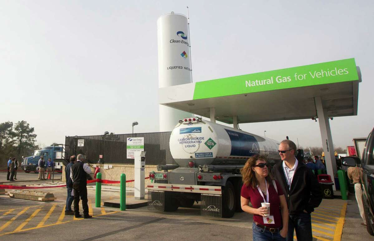 April Schroer and Terry Brey with Noble Energy tour a LNG fuel station at the Pilot-Flying J Travel Center on Monday, Jan. 21, 2013, in Baytown. The tour was a kickoff to a three-day conference on liquified natural gas. ( J. Patric Schneider / For the Chronicle )