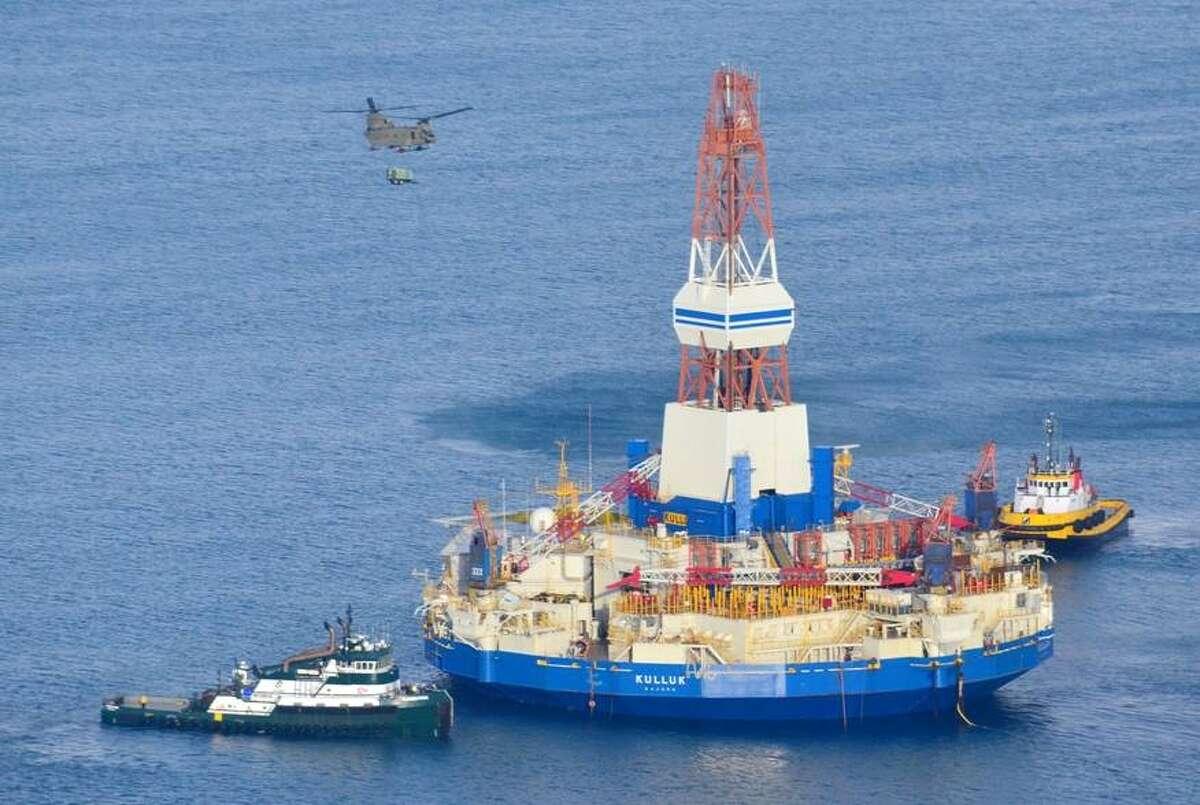 Vessels tow Shell's Kulluk drilling rig on Monday, Jan. 7, 2013 after freeing it from Alaska's Sitkalidak Island, where it ran aground Dec. 31.