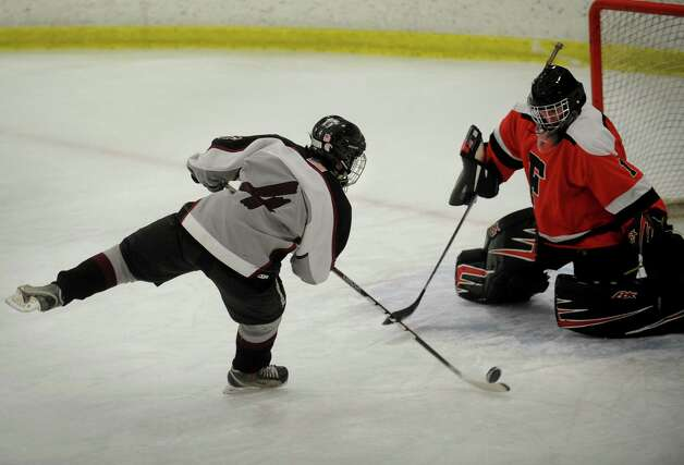 Milford's Robert Buskey is stopped on a breakaway shot by Fairfield goalie Connor Frawley during their boys hockey matchup at the Milford Ice Pavilion on Monday, January 21, 2013. Photo: Brian A. Pounds