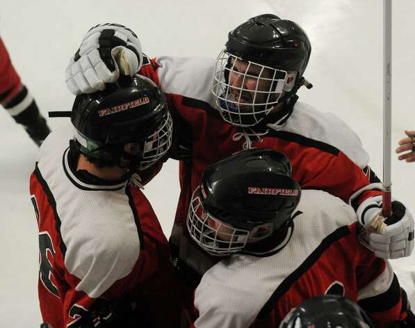 Fairfield's Conor Scharlop, facing, celebrate his second period goal with teammates during their boys hockey matchup with Milford at the Milford Ice Pavilion on Monday, January 21, 2013. Photo: Brian A. Pounds