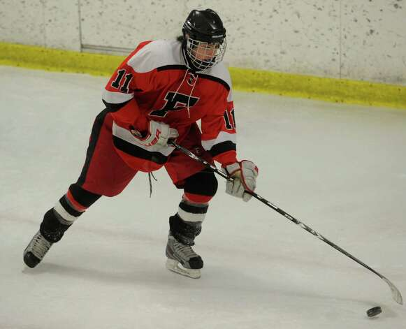 Fairfield's Kevin Robinson plays the puck during their boys hockey matchup with Milford at the Milford Ice Pavilion on Monday, January 21, 2013. Photo: Brian A. Pounds