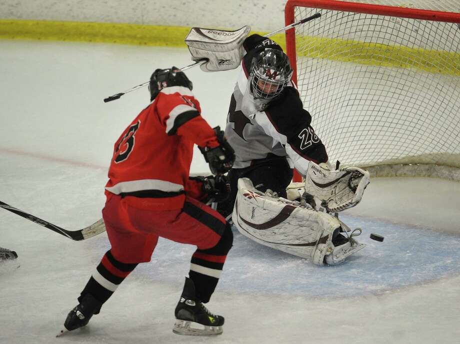 Milford goalie John DePalma makes a save on a shot by Fairfield's Charlie Meder during their boys hockey matchup at the Milford Ice Pavilion on Monday, January 21, 2013. Photo: Brian A. Pounds