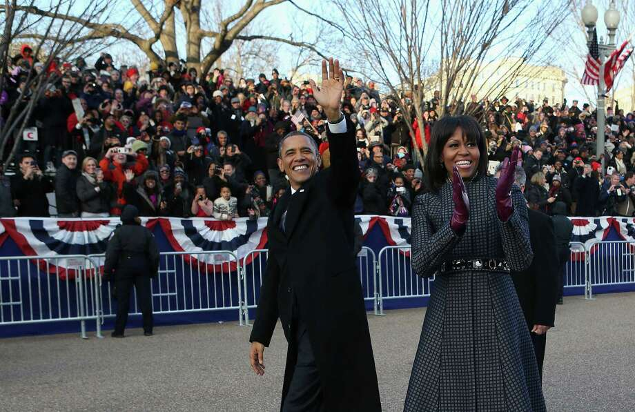 President Barack Obama and first lady Michelle Obama walk down Pennsylvania Avenue in the inaugural parade. Photo: Doug Mills, POOL / Pool The New York Times