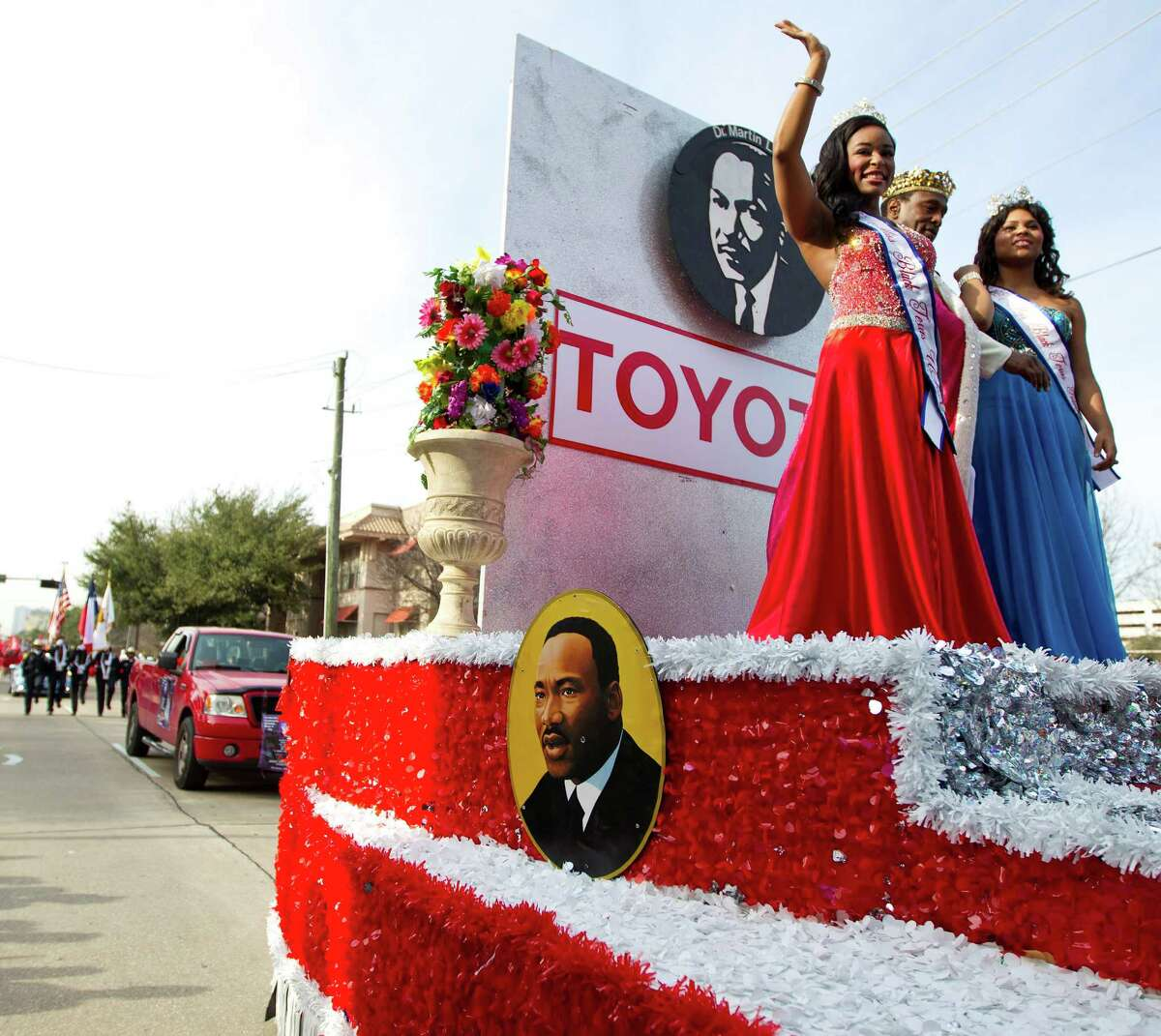 """""""Miss Black Texas USA"""" Dymond Elise Hayes, 21, left, joins Chandler Foreman, 16, """"Miss Black Texas Talented Teen,"""" on the Grand Marshal's float for the 19th annual MLK Grande Parade."""