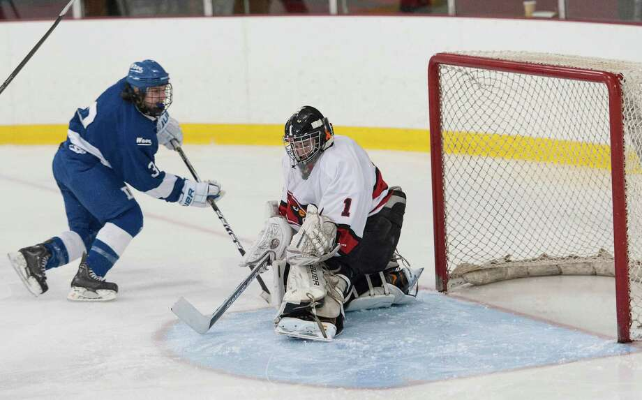 Darien high school's Thomas Watters gets a shot by Greenwich high school goalie Bryan Archino to score a goal in a boys ice hockey game played at Dorothy Hamill Rink, Greenwich CT on Monday January 21st, 2013. Photo: Mark Conrad / Stamford Advocate Freelance