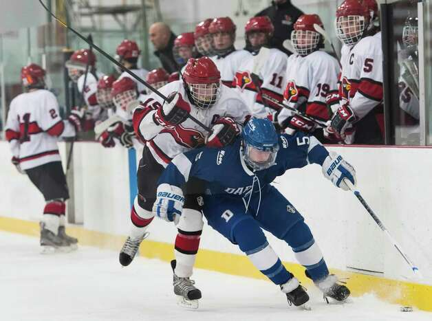 Greenwich high school's Reed Brady takes Darien high school's Owen Koorbusch to the boards in a boys ice hockey game played at Dorothy Hamill Rink, Greenwich CT on Monday January 21st, 2013. Photo: Mark Conrad / Stamford Advocate Freelance