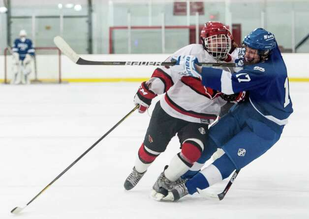 Greenwich high school's Paul Macken checks Darien high school's Aidan Loh at mid-ice in a boys ice hockey game played at Dorothy Hamill Rink, Greenwich CT on Monday January 21st, 2013. Photo: Mark Conrad / Stamford Advocate Freelance