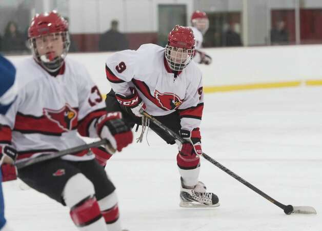 Greenwich high school's Alex Bastone prepares to take a shot in a boys ice hockey game against Darien high schoolplayed at Dorothy Hamill Rink, Greenwich CT on Monday January 21st, 2013. Photo: Mark Conrad / Stamford Advocate Freelance