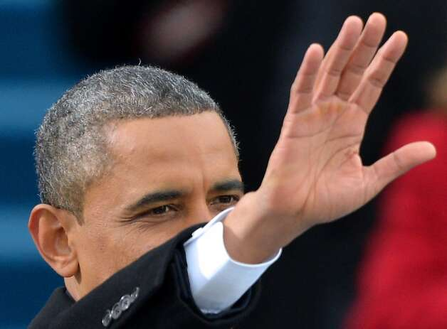President Obama waves to the crowd after taking the oath of office at the Capitol. Obama laid out a liberal governing philosophy in a 15-minute speech. Photo: Jewel Samad, AFP/Getty Images