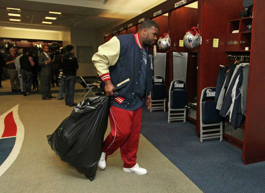 New England Patriots defensive tackle Brandon Deaderick  carries a trash bag of his belongs through the locker room at Gillette Stadium in Foxborough, Mass., Monday, Jan. 21, 2013. The Patriots wrap up their season after Sunday's night's loss to the Baltimore Ravens in the AFC Championship game. (AP Photo/Stew Milne) Photo: Stew Milne