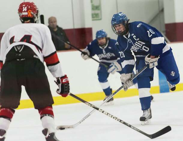 Darien high school's Trent Bergin winds up to take a shot in a boys ice hockey game against Greenwich high school played at Dorothy Hamill Rink, Greenwich CT on Monday January 21st, 2013. Photo: Mark Conrad / Stamford Advocate Freelance