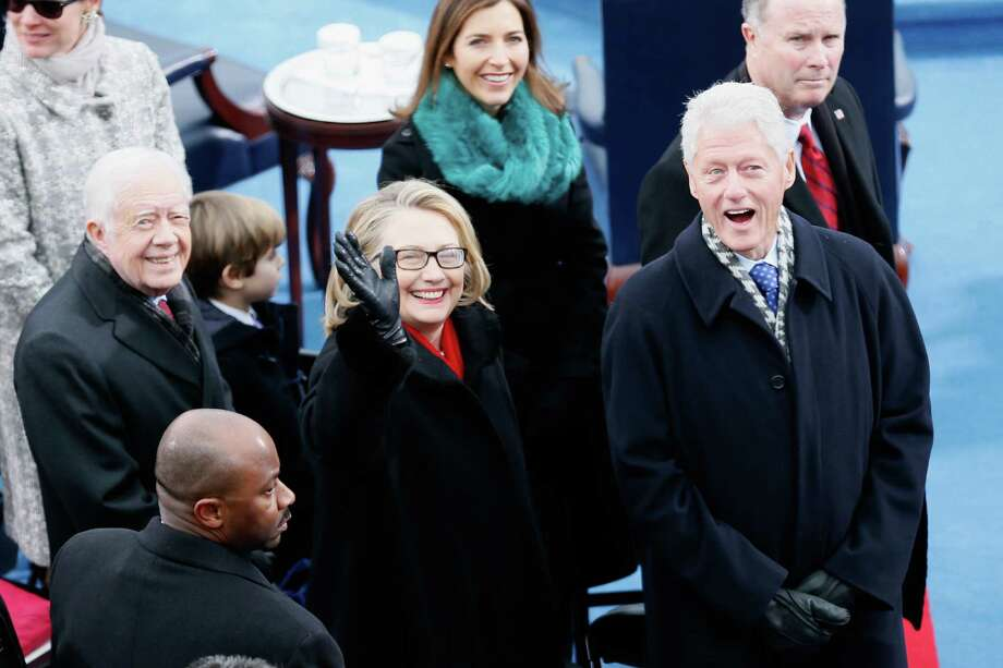 Presidents Jimmy Carter and Bill Clinton flank Secretary of State Hillary Rodham Clinton  as they arrive on the west front of the U.S. Capitol on Monday. Photo: Rob Carr, Staff / 2013 Getty Images