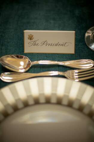 A place card marks Obama's seat for the luncheon. Photo: Allison Shelley, Getty Images