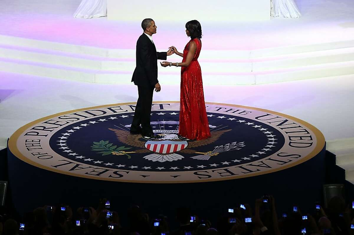 President Barack Obama dances with first lady Michelle Obama at the Commander in Chief's Ball on Monday, January 21, 2013 in Washington, D.C. (Pool photo by Justin Sullivan/Getty Images/MCT)