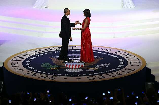 The president and first lady Michelle Obama dance at the Commander in Chief's Ball, one of two star-studded galas held at the Washington Convention Center. Photo: Justin Sullivan/Getty, McClatchy-Tribune News Service