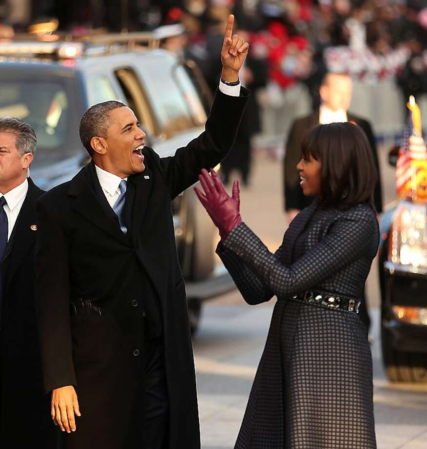 President Barack Obama and first lady Michelle Obama wave at the crowd as the inaugural parade makes it way to the White House on Monday, January 21, 2013 in Washington, D.C. (Pool photo by Chip Somodevilla/Getty Images/MCT) Photo: Chip Somodevilla/Getty Images, McClatchy-Tribune News Service