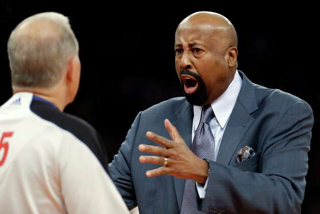 New York Knicks head coach Mike Woodson complains to referee Bennett Salvatore, left, in the first half of their NBA basketball game against the Brooklyn Nets at Madison Square Garden in New York, Monday, Jan. 21, 2013. The Nets won 88-85. (AP Photo/Kathy Willens) Photo: Kathy Willens