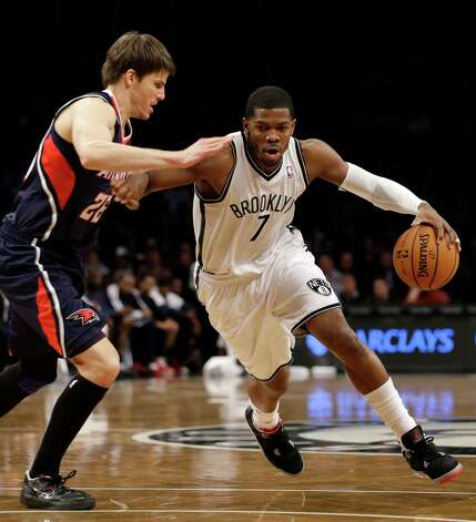 Brooklyn Nets guard Joe Johnson (7) drives past Atlanta Hawks guard Kyle Korver (26) in the first half of their NBA basketball game at the Barclays Center, Friday, Jan. 18, 2013, in New York. (AP Photo/Kathy Willens) Photo: Kathy Willens