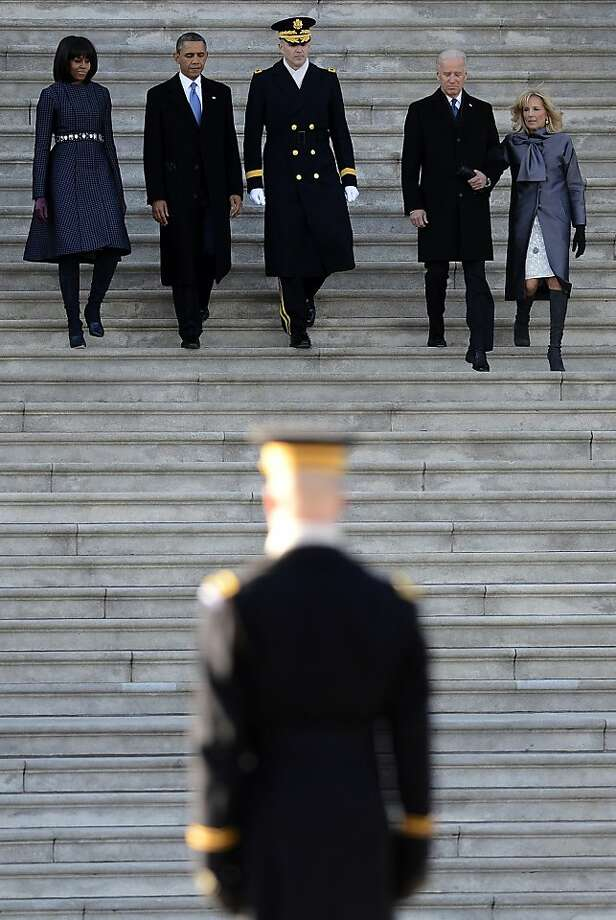 President Barack Obama, second from left, accompanied by, from left, first lady Michelle Obama, Army Maj. Gen. Michael J. Linnington, Vice President Joe Biden and his wife Dr Jill Biden, arrive to review the troops on the east side of the Capitol in Washington, Monday, Jan. 21, 2103, following the president's ceremonial swearing-in ceremony during the 57th Presidential Inauguration.  (AP Photo/CJ Gunther, Pool) Photo: CJ Gunther, Associated Press