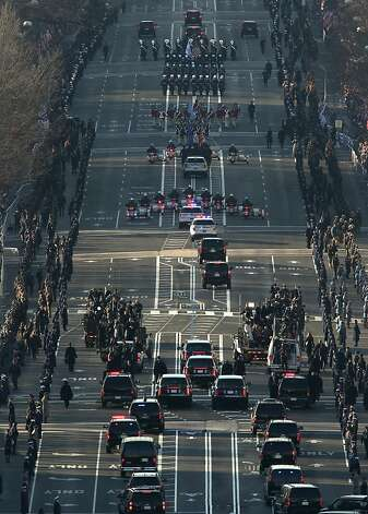 The presidential motorcade takes part in the inaugural parade on Monday, January 21, 2013 in Washington, D.C. (Pool photo by Molly Riley/AFP/MCT) Photo: Molly Riley/AFP, McClatchy-Tribune News Service