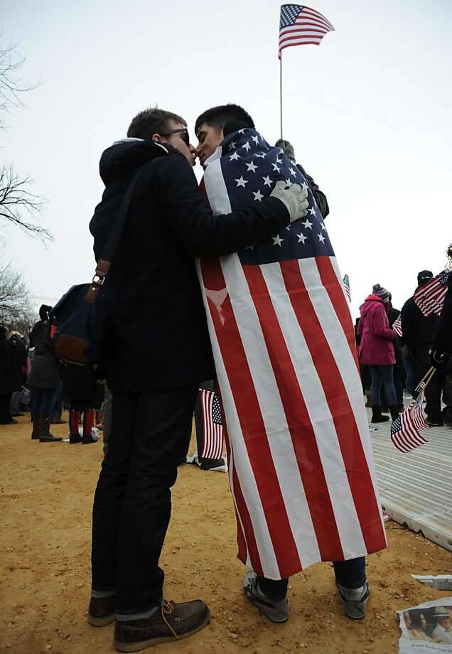 Greg Josken, of New York City (left) and Gustavo Cifuentes, of Jersey City, New Jersey, embrace during the inauguration ceremony on the Natonal Mall, Monday, January 21, 2013 in Washington, D.C. (Andre Chung/MCT) Photo: AndrÈ Chung, McClatchy-Tribune News Service